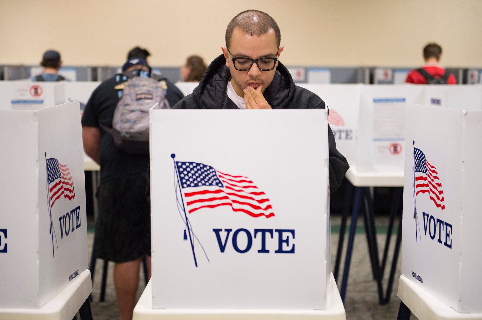 Matthew Moreno looks over his choices in the voting booth during early voting at CSU's Lory Student Center on Monday, November 5, 2018. Election judges said a steady stream of students were turning out to vote the day before Election Day. AUSTIN HUMPHREYS/THE COLORADOAN