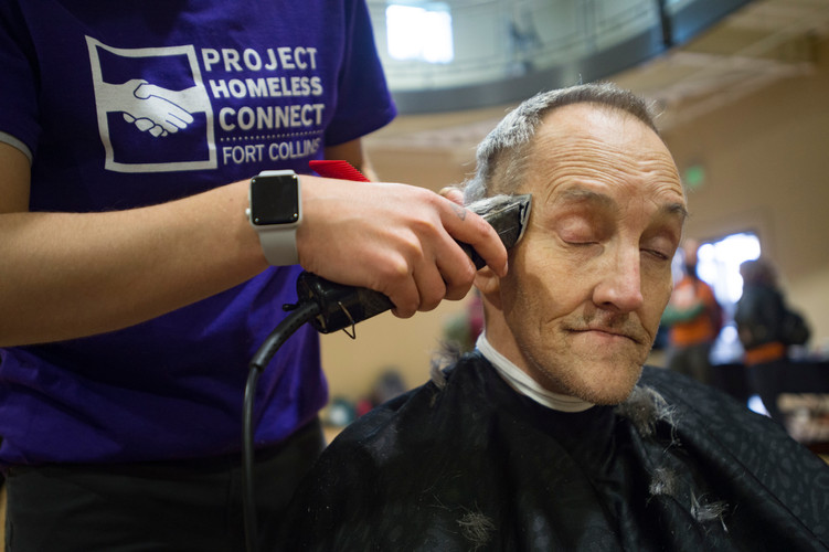 "Stephen Wildgen, known as ""The Colonel,"" gets a free haircut as he attends a Project Homeless Connect event at the Northside Aztlan Center on Friday, April 13, 2018. Services like health screenings, clothing distribution and bike repair were utilized by hundreds of homeless or at-risk people."