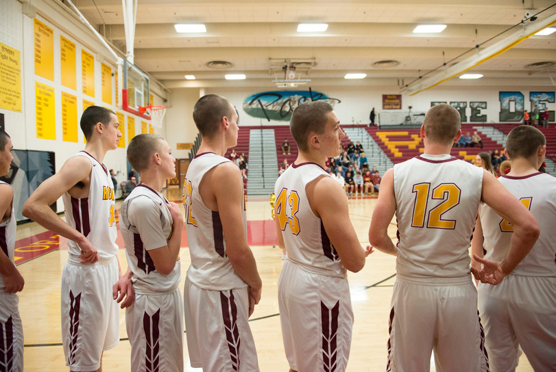 The Lobos basketball team lines up for the National Anthem before taking on Greeley West on Tuesday, January 8, 2019. The team shaved their heads a few weeks after finding out their center, Carter Edgerley, was diagnosed with cancer. AUSTIN HUMPHREYS/THE COLORADOAN