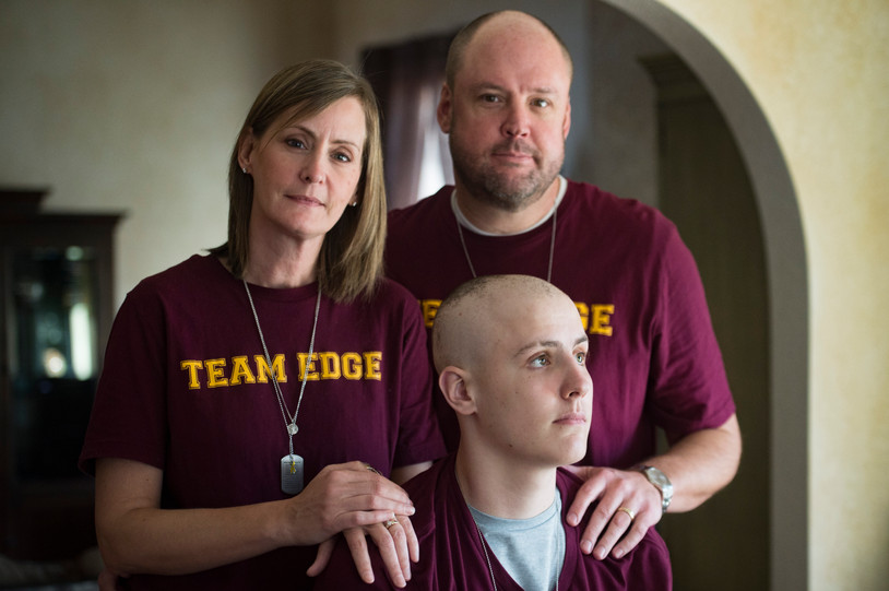 Michelle and Michael Edgerley pose for a photo with their son, Carter, 17, at their home in Fort Collins on Tuesday, January 8, 2019. Carter, a senior at Rocky Mountain High School, was diagnosed with cancer in December and has received an outpour of support from friends, family and teachers. AUSTIN HUMPHREYS/THE COLORADOAN
