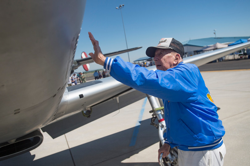 Veteran Gerald Ravenscroft admires a P-51 Mustang during the Collings Foundation's Wings of Freedom Tour as it stops at Northern Colorado Regional Airport on Saturday, July 14, 2018. Ravenscroft was shot down in his own P-51 after being hit over mainland China in 1945. Ravenscroft had to find his way back to friendly lines with the help of Chinese villages for the next 25 days.