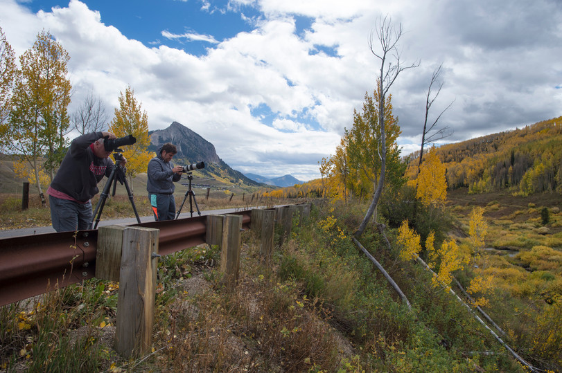 Steve Cullen, visiting from Washington, and Nick Selway from Hawaii snap photos from the side of the road in Washington Gulch near Crested Butte, Colorado on Friday, September 22, 2017.