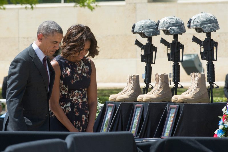 President Barack Obama and First Lady Michelle Obama honor the three soldiers killed in a shooting at Fort Hood during a ceremony on April 9, 2014. A memorial service was held on the army base to pay tribute to the soldiers. AUSTIN HUMPHREYS/UNIVERSITY STAR