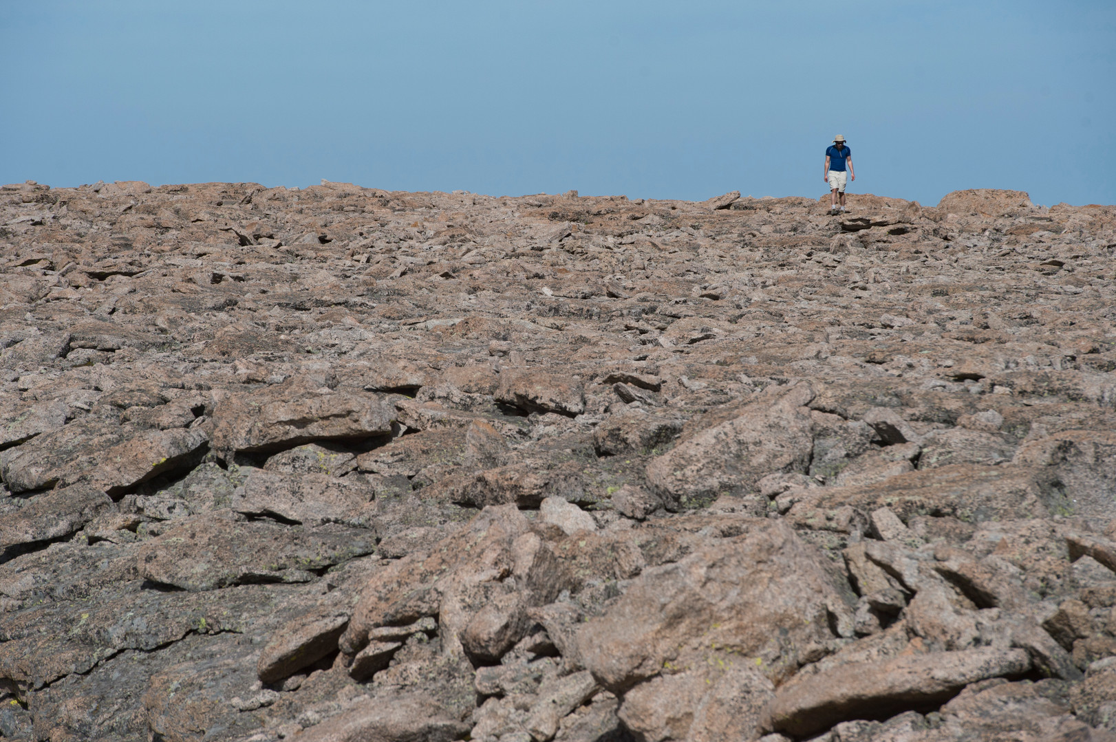 A climber walks around the summit of Longs Peak in Rocky Mountain National Park on Friday, July 19, 2017.