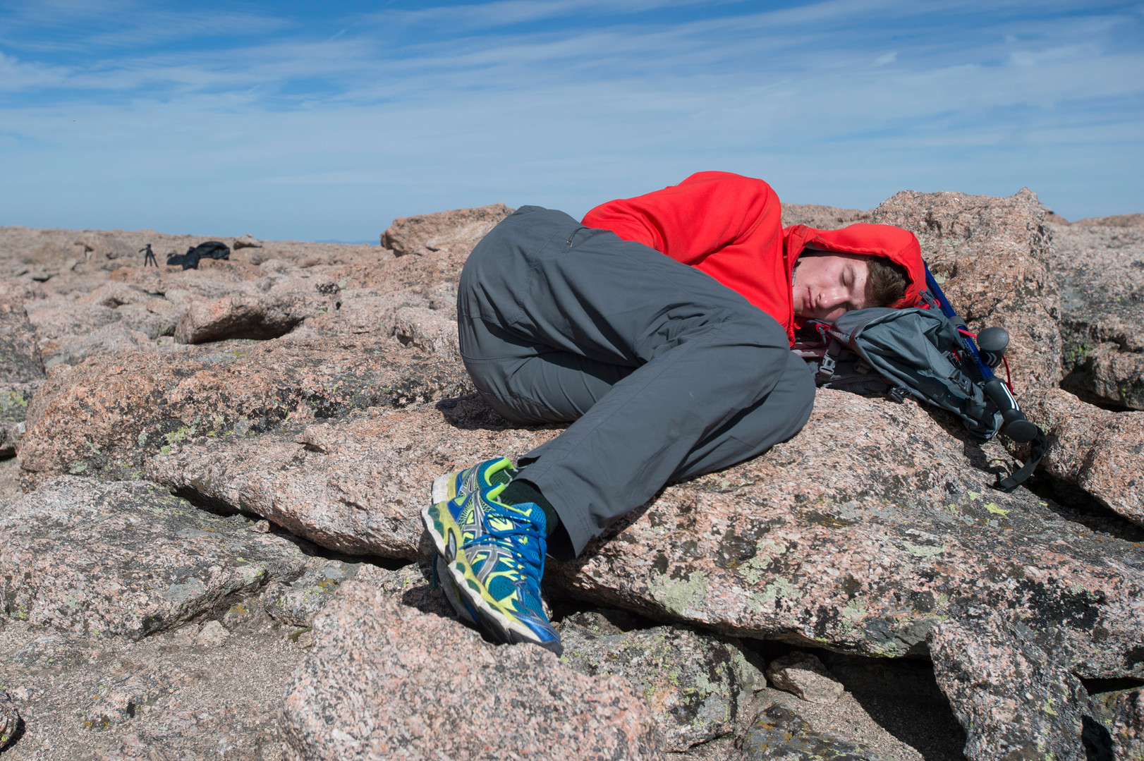 A climber finds a comfortable rock to take a nap on the summit of Longs Peak in Rocky Mountain National Park on Friday, July 19, 2017.