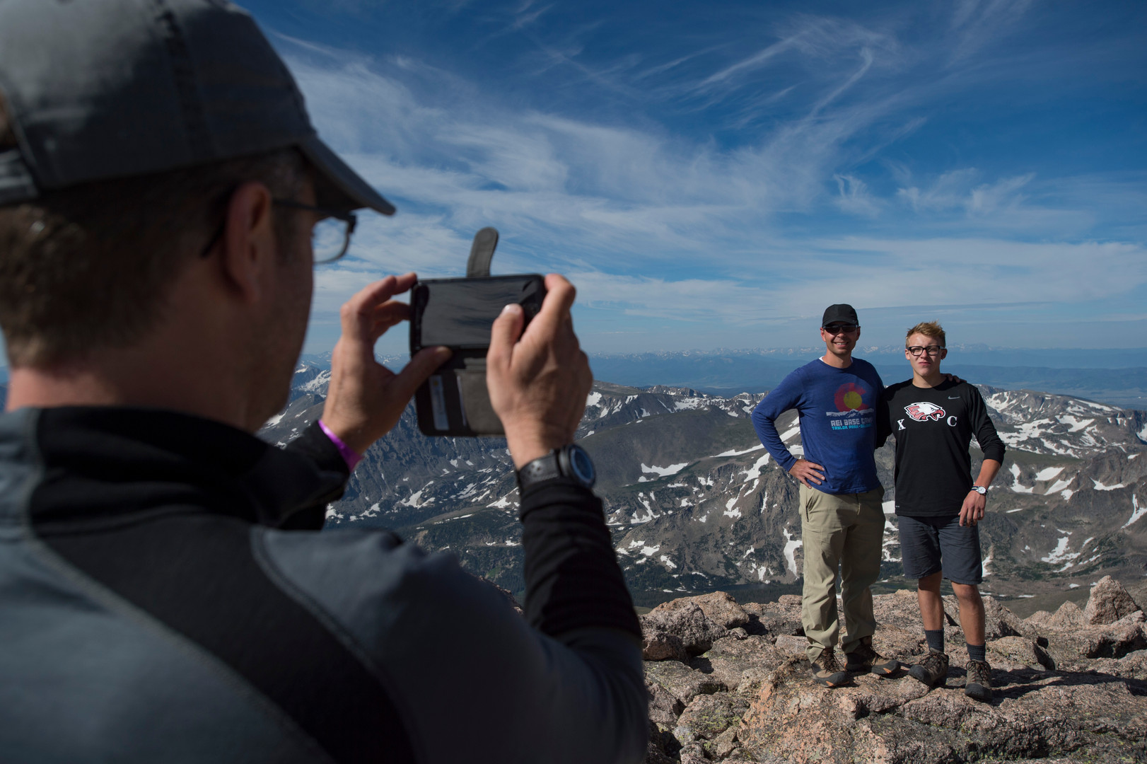 Climbers pose for photos on the summit of Longs Peak in Rocky Mountain National Park on Friday, July 19, 2017.