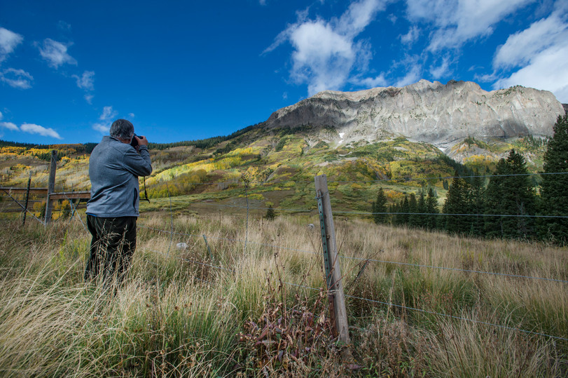 Steve Bressler of Lakewood snaps a few photos along Gothic Road near Crested Butte, Colorado on Friday, September 22, 2017. The aspen trees in the area are reaching their peak fall coloration.