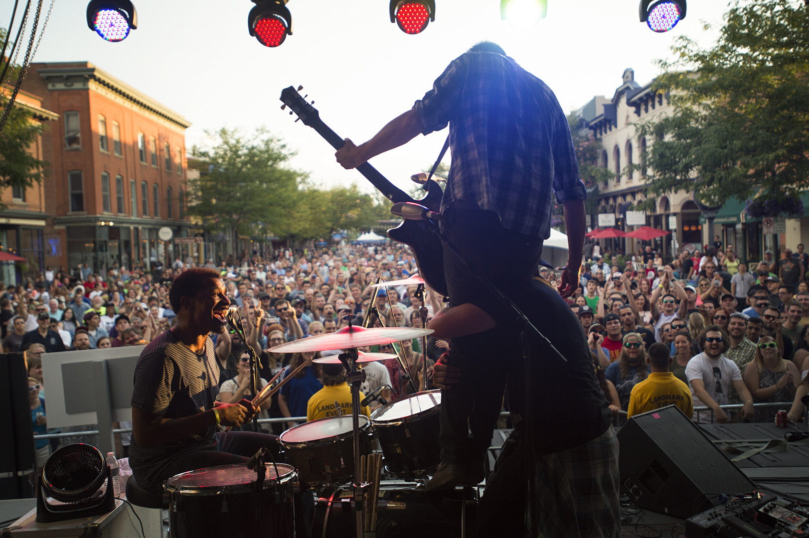 In the Whale guitarist Nate Valdez is lifted in the air by Brandon Whalen as they perform on Linden Street during Bohemian Nights at NewWestFest on Aug. 13, 2016. In the Whale guitarist Nate Valdez is lifted in the air by Brandon Whalen as they perform on Linden Street during Bohemian Nights at NewWestFest Saturday, August 13, 2016.