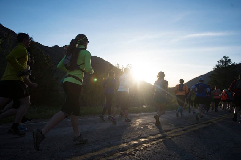 The sun rises over the foothills as runners move through Poudre Canyon during the Colorado Marathon on Sunday, May 6, 2018. AUSTIN HUMPHREYS/THE COLORADOAN
