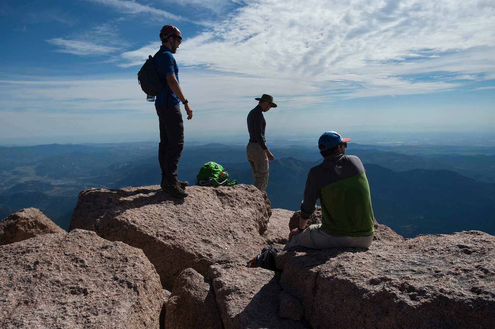Climbers take in the view from the summit of Longs Peak in Rocky Mountain National Park on Friday, July 19, 2017.