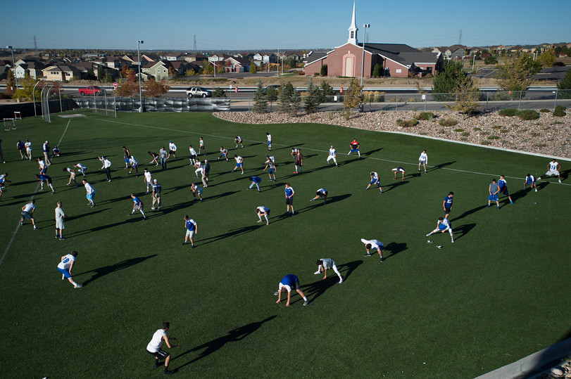 4:42 p.m. - Poudre High School stretches out at EchoPark Stadium in Parker before taking on Legend High School Thursday, October 13, 2016.