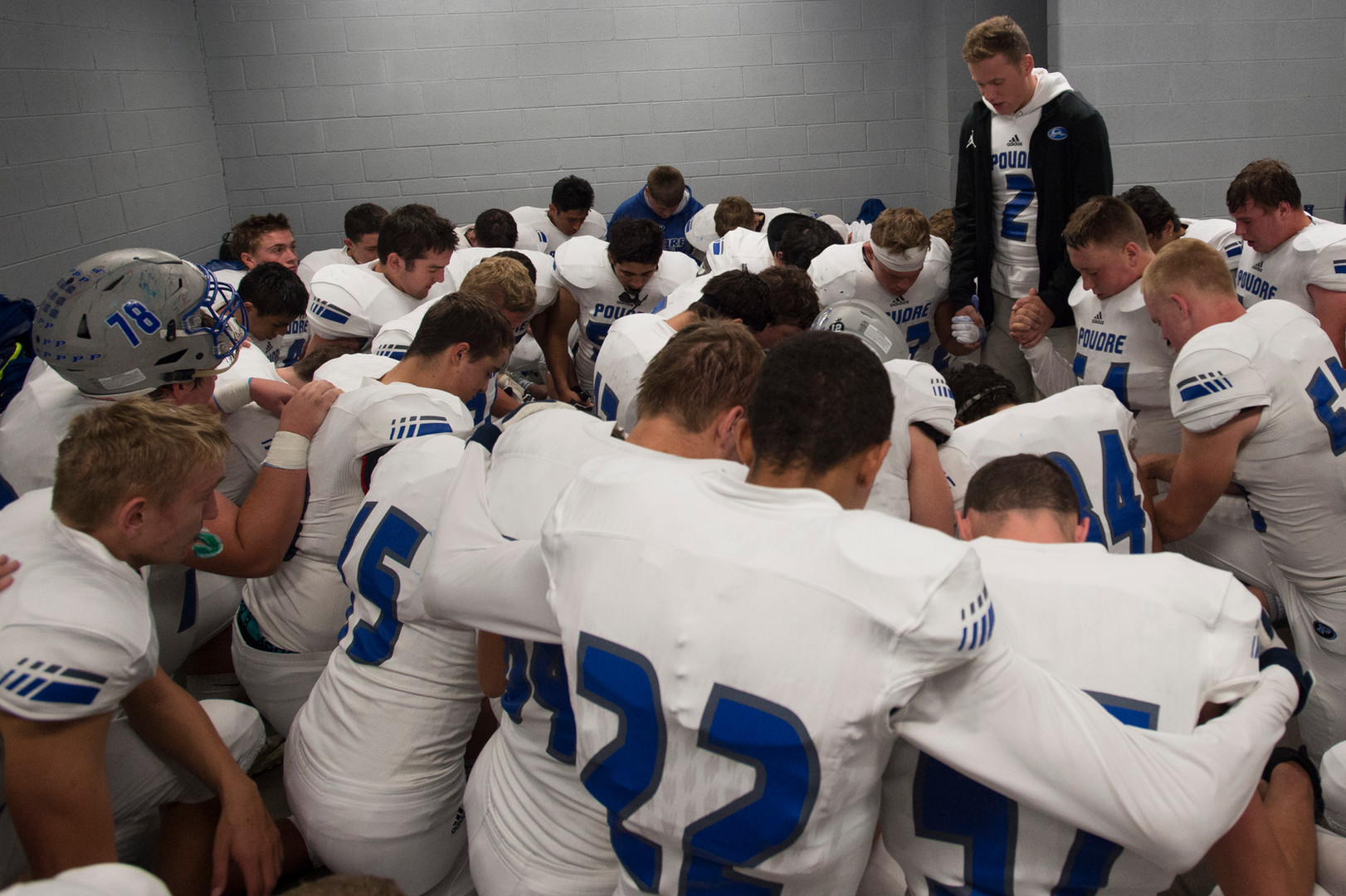 6:47 p.m. - Troy McFadden leads the Impalas in a prayer before they exit the locker room at EchoPark Stadium in Parker Thursday, October 13, 2016.