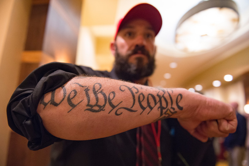 Ty Winter shows off a tattoo inspired by the United States Constitution during a Colorado GOP watch party at the Denver Marriott South at Park Meadows in Lone Tree on Election Day, Tuesday, November 6, 2018. AUSTIN HUMPHREYS/THE COLORADOAN
