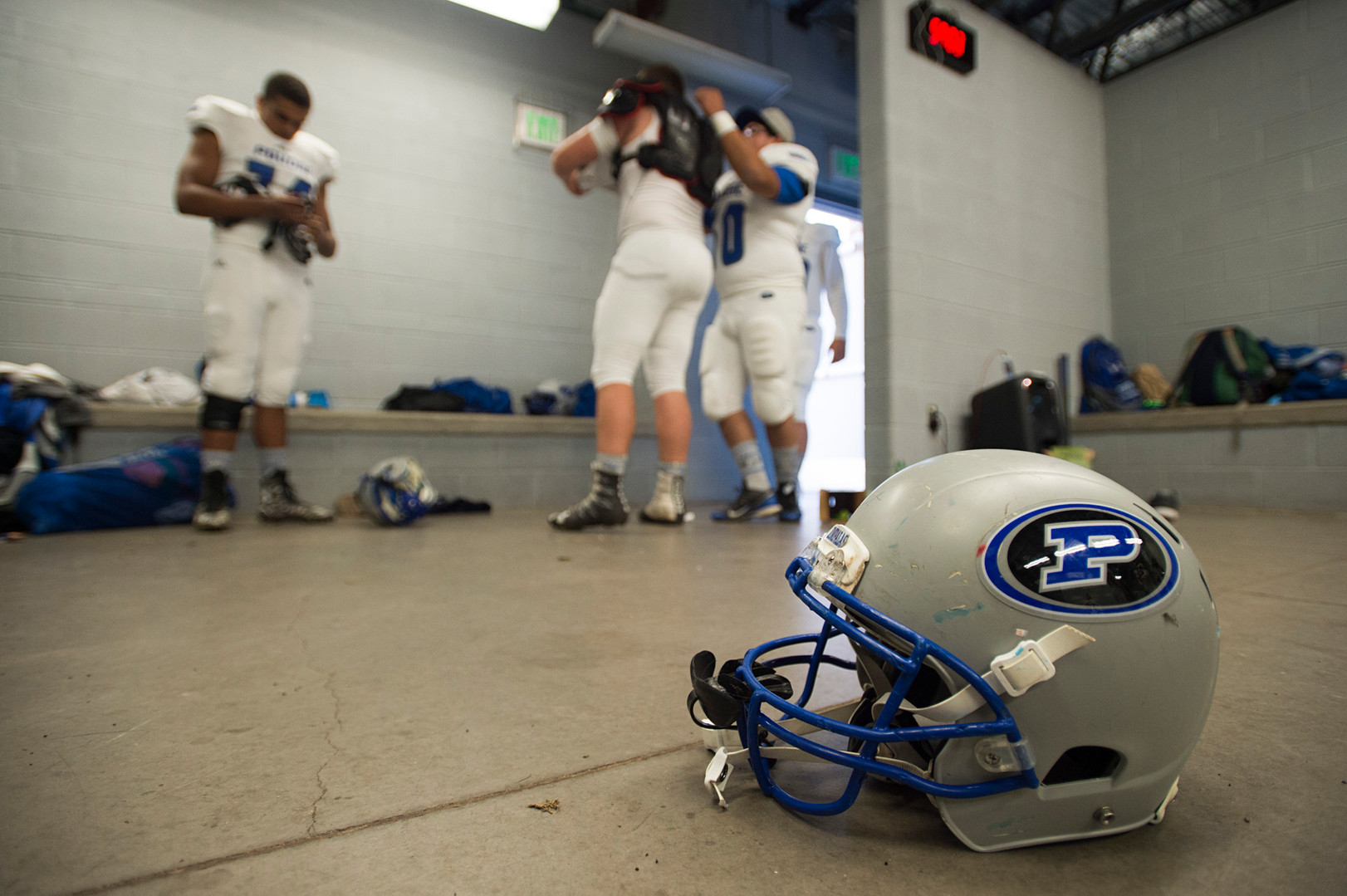 6:00 p.m. - The last few players file out of the locker room at EchoPark Stadium in Parker before Poudre takes on Legend High School Thursday, October 13, 2016.