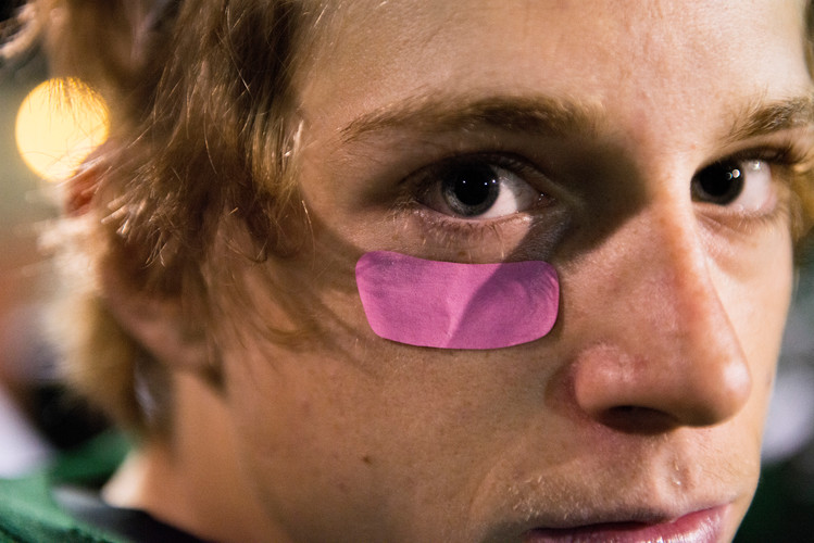 Fossil Ridge High School defensive back Ryan Ressler wears a pink anti-glare sticker below his eye to promote breast cancer awareness during a game against Rocky Mountain at French Field on Friday, October 5, 2018. AUSTIN HUMPHREYS/THE COLORADOAN