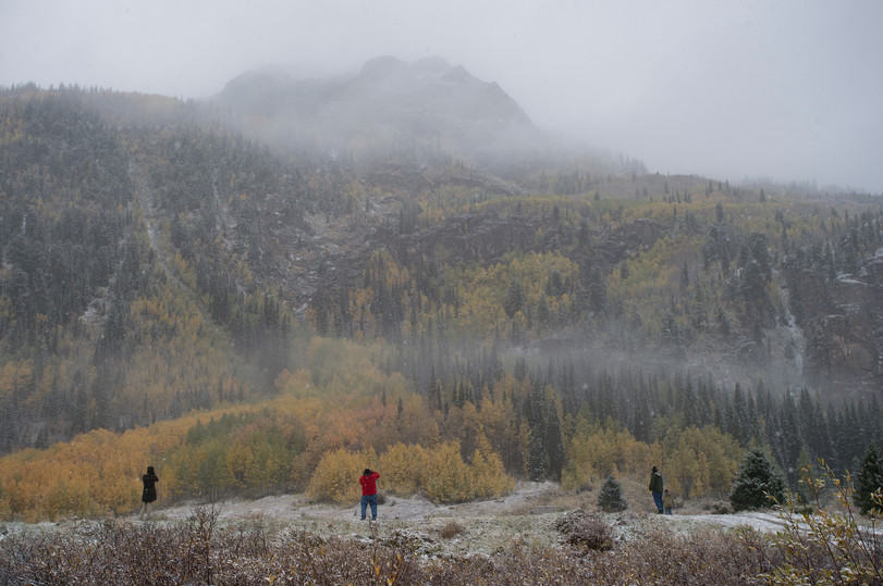 """Travelers stop to take photos of an early snowfall along U.S. Highway 50, known as the """"Million Dollar Highway,"""" between the towns of Silverton and Ouray, Colorado on Saturday, September 22, 2017."""
