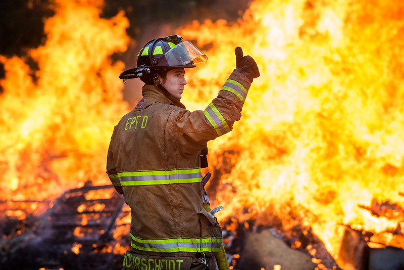 The East Peoria Fire department responds to an illegal burn Tuesday afternoon near Washington Street in East Peoria. Police received a call of concern from an individual who thought the neighboring Merlin 200,000 miles tire shop was on fire. AUSTIN HUMPHREYS/JOURNAL STAR