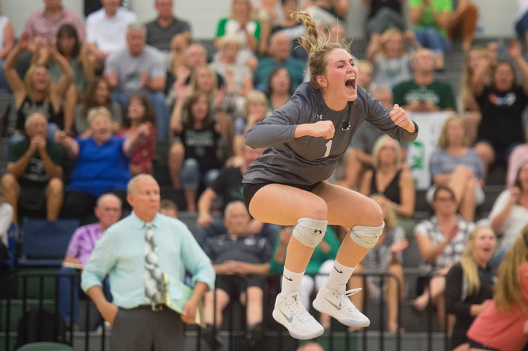 Fossil Ridge senior Charlie Durbin jumps in the air after the SaberCats make a play during a game against Fort Collins High School on Tuesday, September 12, 2018. The SaberCats won 3-1. AUSTIN HUMPHREYS/THE COLORADOAN