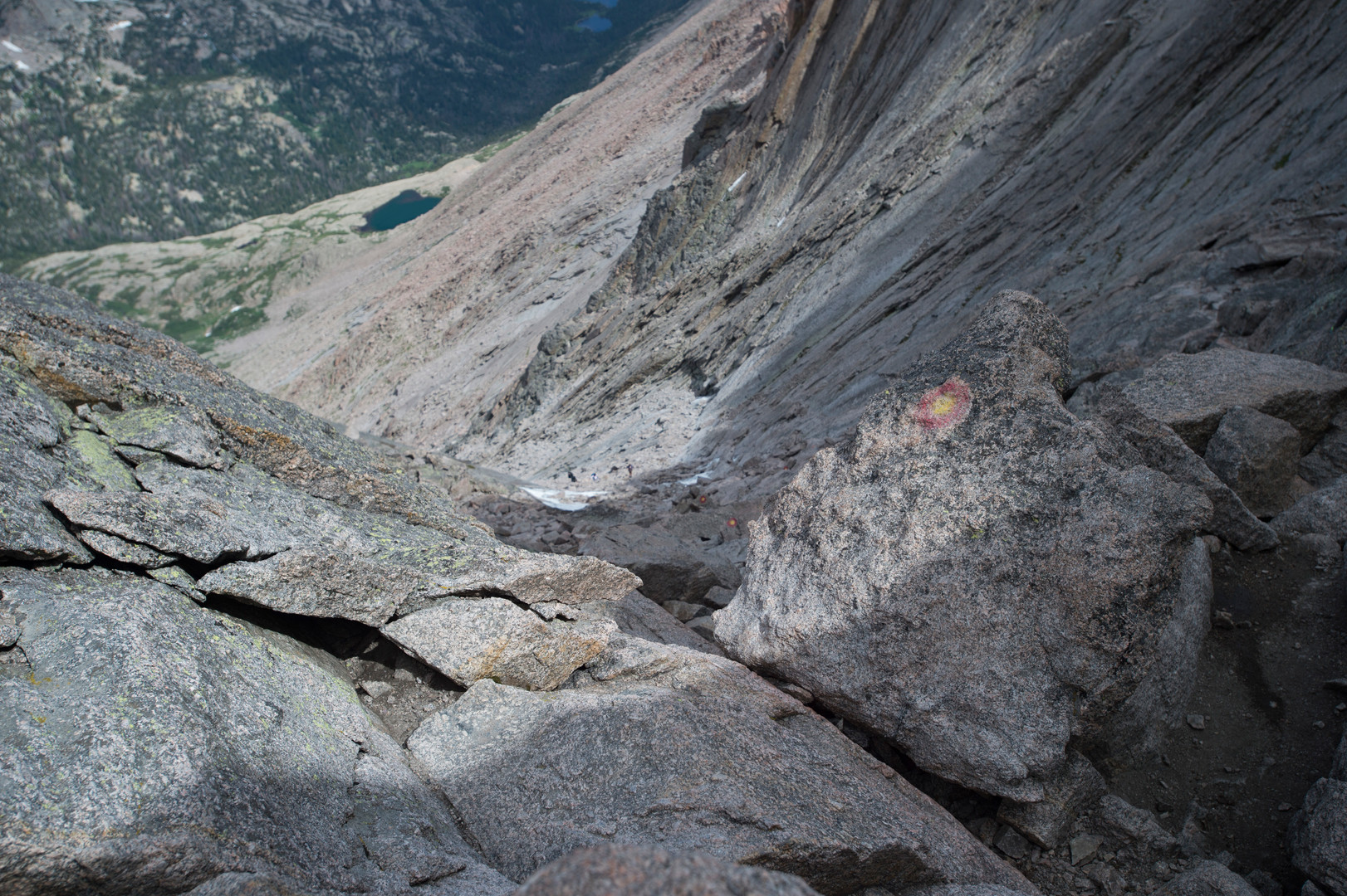 """A bullseye marks the route through """"The Trough"""" on Longs Peak in Rocky Mountain National Park on Friday, July 19, 2017. The trough, comprised of loose rock and gravel, tops out around 13,850 feet in elevation on the route."""
