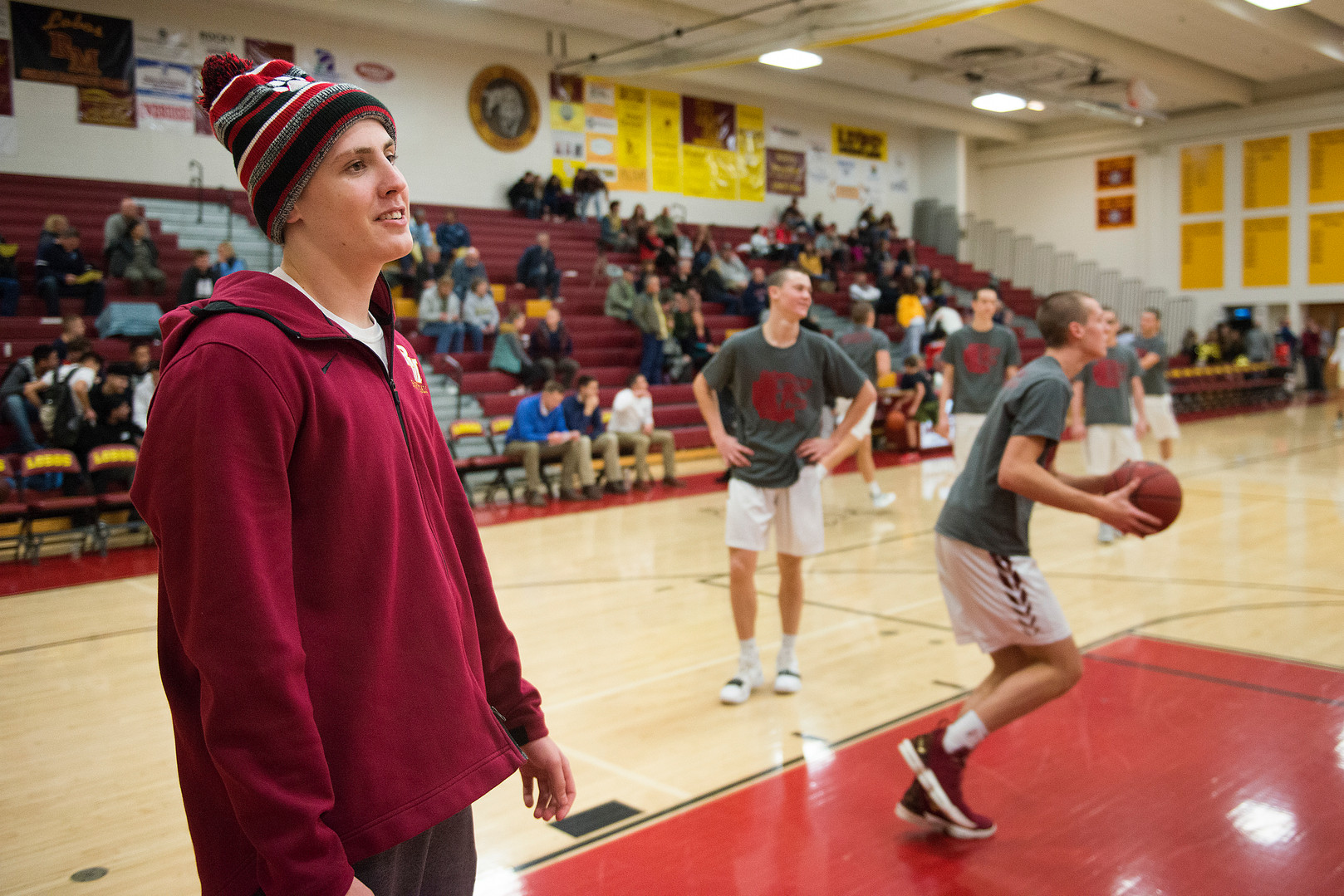 Carter Edgerley watches while the Lobos warm up before taking on Greeley West on Tuesday, January 8, 2019. Carter, a senior at Rocky Mountain High School, was diagnosed with cancer in December and has received an outpour of support from friends, family and teachers. AUSTIN HUMPHREYS/THE COLORADOAN