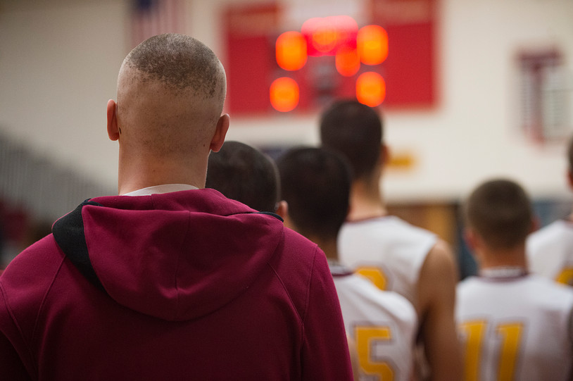 Carter Edgerley lines up with the Lobos during the National Anthem before taking on Greeley West on Tuesday, January 8, 2019. AUSTIN HUMPHREYS/THE COLORADOAN