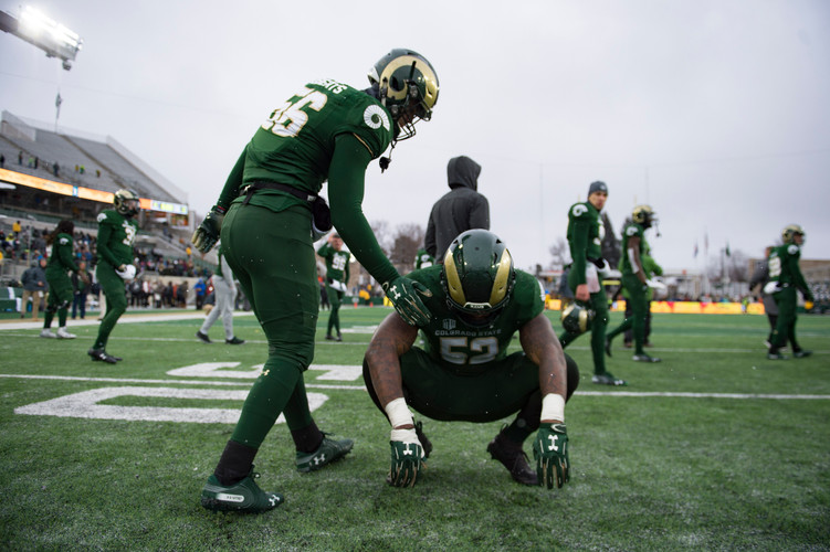 CSU's Rushton Roberts tries to comfort teammate Tre Thomas after the Rams lost 29-24 against Utah State at Canvas Stadium on Saturday, November 17, 2018. AUSTIN HUMPHREYS/THE COLORADOAN