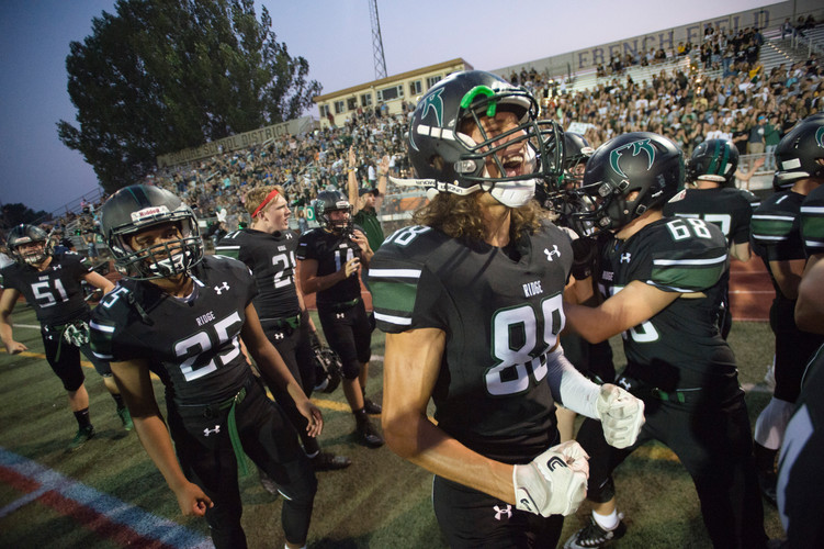 Josh Pales and the Fossil Ridge High School football team celebrate after a play in a game against Castle View at French Field on Thursday, August 23, 2018. AUSTIN HUMPHREYS/THE COLORADOAN