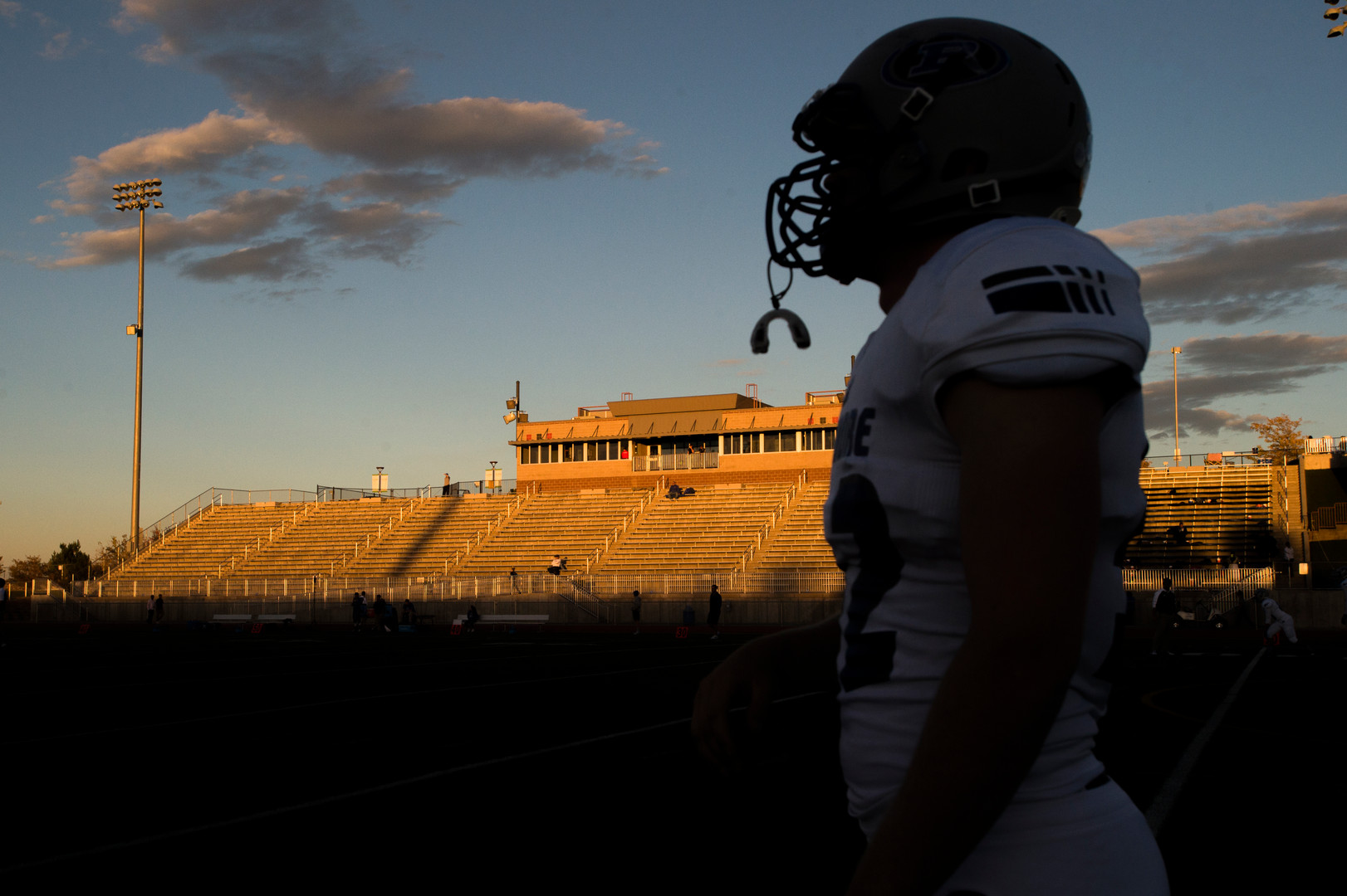 6:06 p.m. - Poudre High School football players warm up at EchoPark Stadium in Parker before taking on Legend High School Thursday, October 13, 2016.