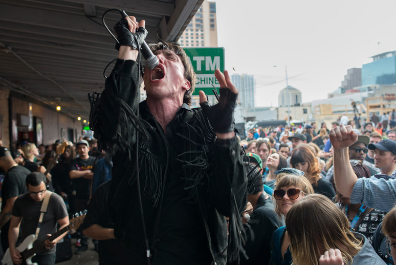 Video performs on the Beerland patio to a crowded sidewalk Friday, March 14, 2014. AUSTIN HUMPHREYS/AUSTIN AMERICAN-STATESMAN