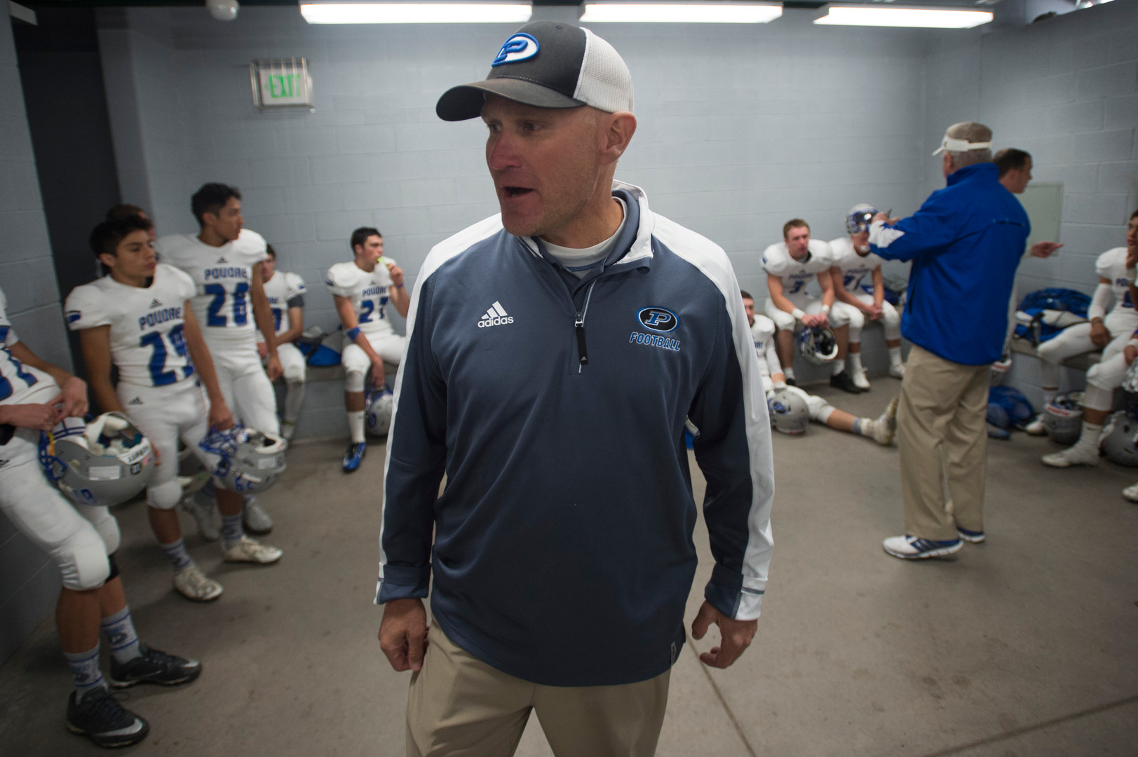 8:04 p.m. - Poudre High School football coach Marty McVicker briefs the team during half time in a game against Legend at EchoPark Stadium in Parker Thursday, October 13, 2016.