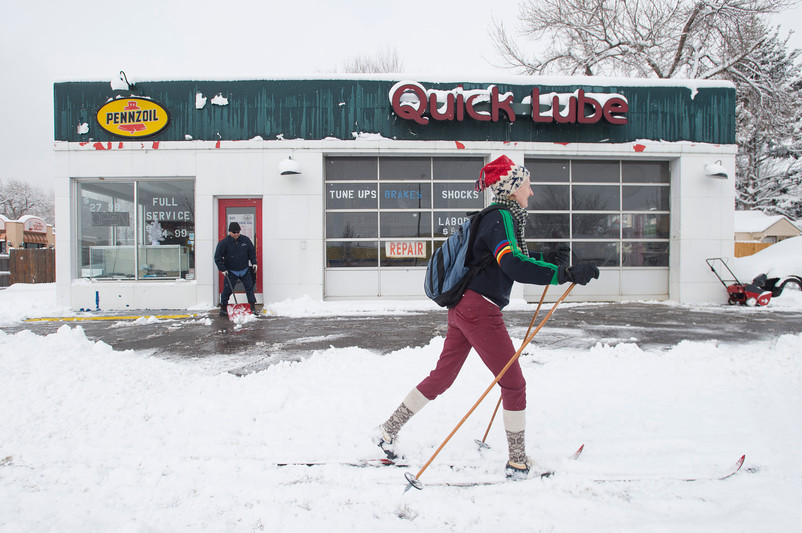 Kelly Zweifel walks to work down College Avenue on a pair of cross-country skis on Thursday, February 1, 2018 in Fort Collins, Colorado. Parts of Northern Colorado received up to five inches of snow in the storm. AUSTIN HUMPHREYS/THE COLORADOAN