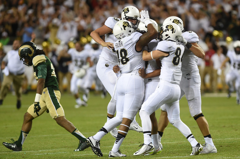 CSU defensive back Preston Hodges walks off the field as the CU Boulder football team celebrates a field goal during overtime Saturday, September 19, 2015 at Sports Authority Field in Denver during the Rocky Mountain Showdown. The Rams lost to the Buffaloes 27-24. AUSTIN HUMPHREYS/THE COLORADOAN