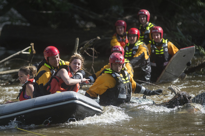Two women are loaded into a boat by Poudre Fire Authority personnel during a water rescue on the Cache la Poudre River west of College Ave. Friday, June 10, 2016. Four tubers were rescued after becoming stranded in the middle of the fast moving current. AUSTIN HUMPHREYS/THE COLROADOAN