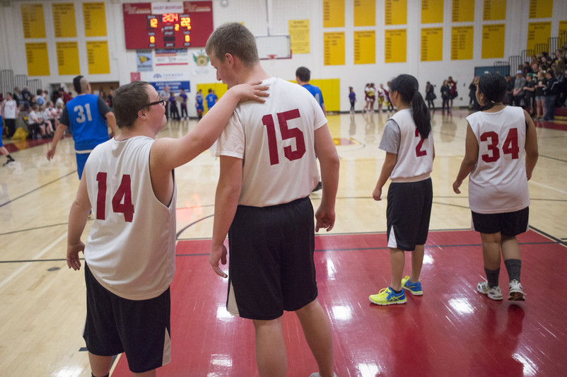 Cory Breslin of the Lobos shares a moment with teammate Justin Allen during a Unified Basketball game against Poudre at Rocky Mountain High School Wednesday, January 20, 2016. The Unified program allows students with physical or mental disabilities to participate in activities like high school sports. AUSTIN HUMPHREYS/THE COLORADOAN