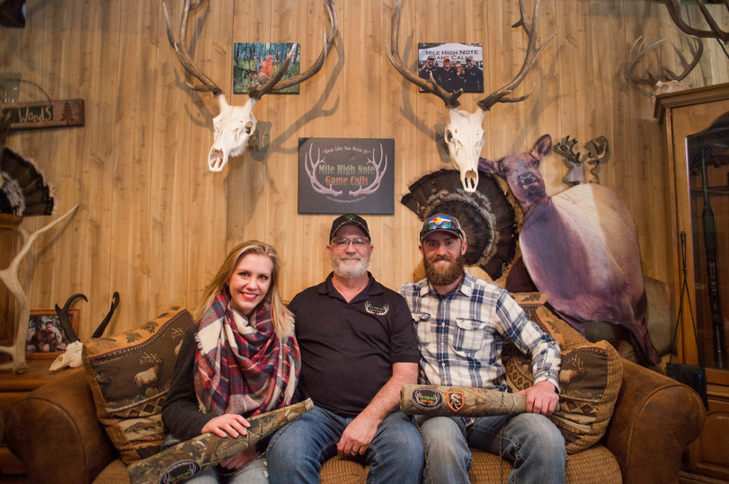 Tom Diesing, center, poses for a photo with his children, Jessi Slaten and Thomas Diesing at their home in Loveland on Wednesday, March 28, 2018. The family has won state and national titles for their ability to replicate elk calls. AUSTIN HUMPHREYS/THE COLORADOAN