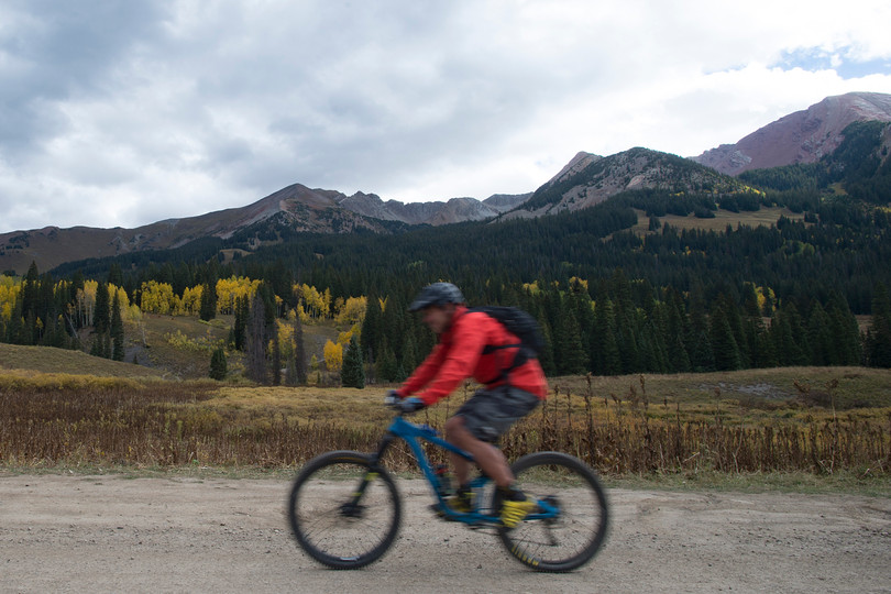 A mountain biker travels down Gothic Road near Crested Butte, Colorado on Friday, September 22, 2017.