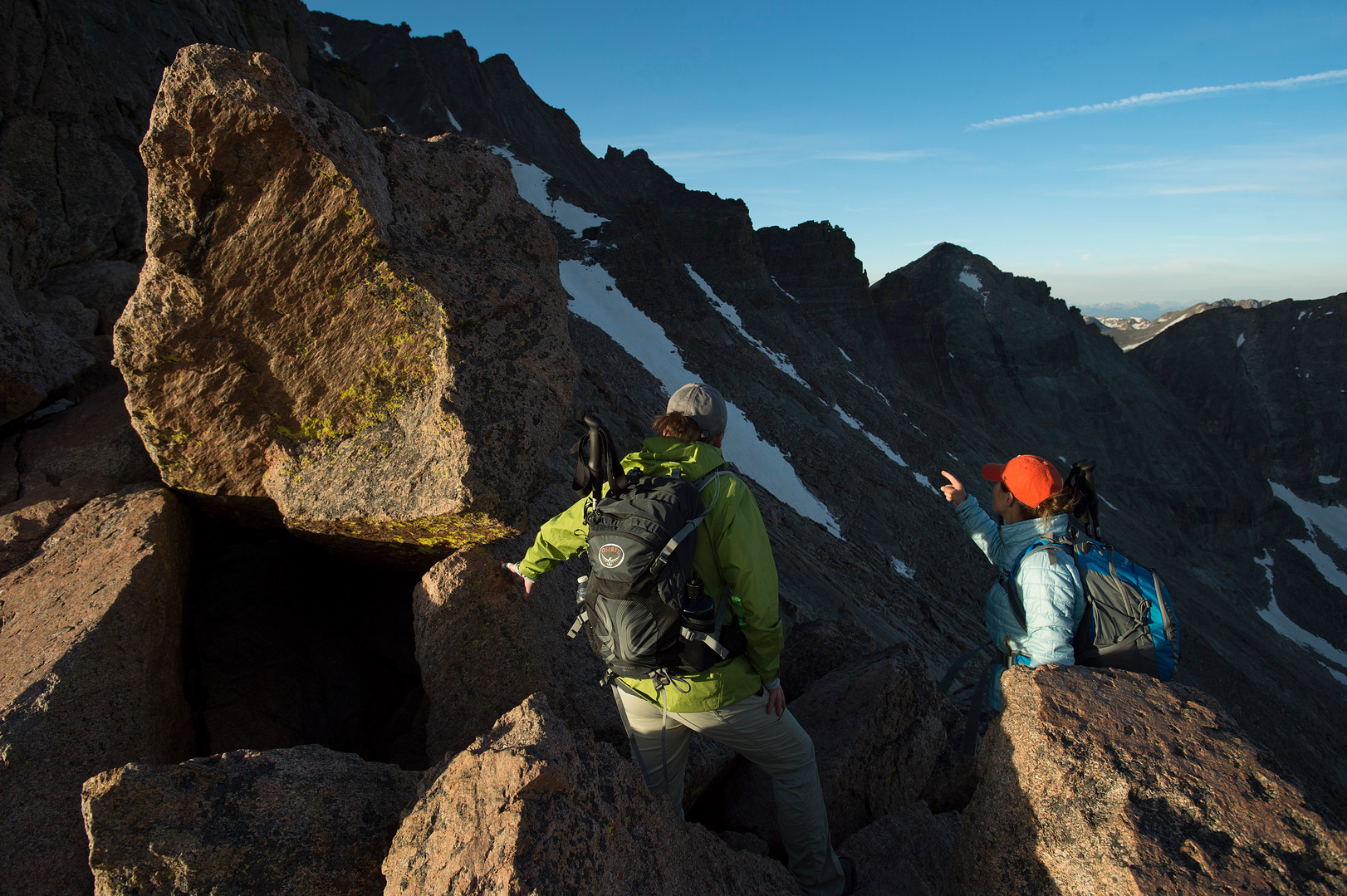 Climbers look on to the next parts of the Keyhole Route from the Keyhole on Longs Peak in Rocky Mountain National Park on Friday, July 19, 2017. The route's namesake, the Keyhole, is a notch in a ridge above the Longs Peak boulder field. Climbing becomes much more difficult after this point with class 3 rock and exposed terrain leading to the summit.