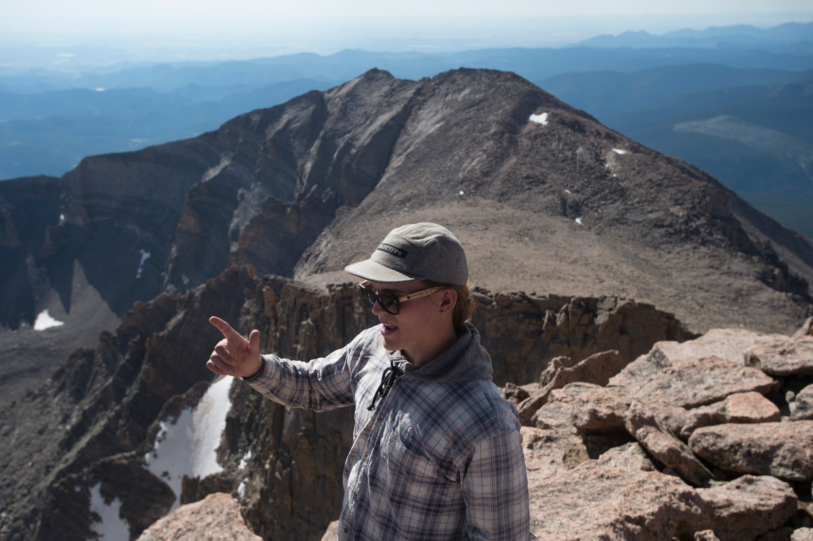 Nick Larson, from Wisconsin, takes in the view from the summit of Longs Peak in Rocky Mountain National Park on Friday, July 19, 2017. Mount Meeker, at 13,911 feet in elevation, is seen in the background.