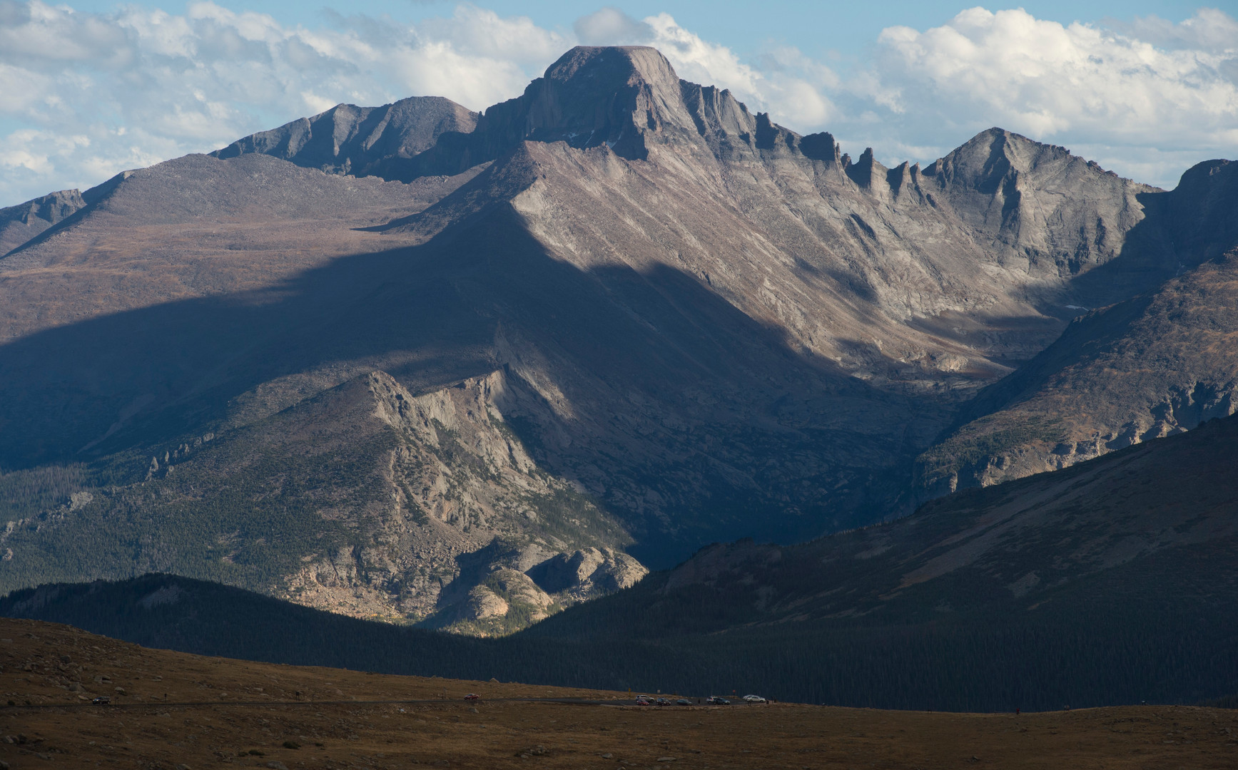 Evening light shines on Longs Peak viewed from Trail Ridge Road in Rocky Mountain National Park.