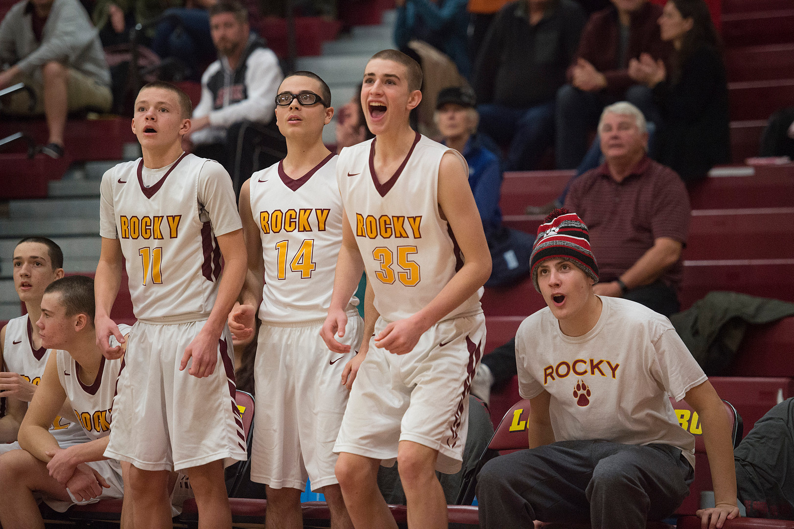 Carter Edgerley cheers for his teammates on the Rocky Mountain High School basketball team from the bench after a Lobos play in a game against Greeley West on Tuesday, January 8, 2019. The Lobos lost the game to Spartans 63-53. AUSTIN HUMPHREYS/THE COLORADOAN
