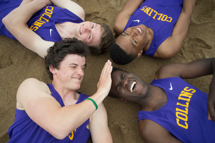 Fort Collins High School long jumpers Allam Bushara, Micaylon Moore, Joey Maguire and Spencer Purnell goof off in the sand pits during practice on Tuesday, April 24, 2018.AUSTIN HUMPHREYS/THE COLORADOAN
