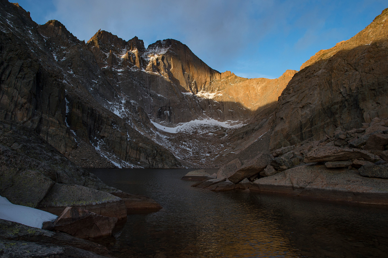First light hits Longs Peak and the Chasm Lake area Tuesday, November 1, 2016.