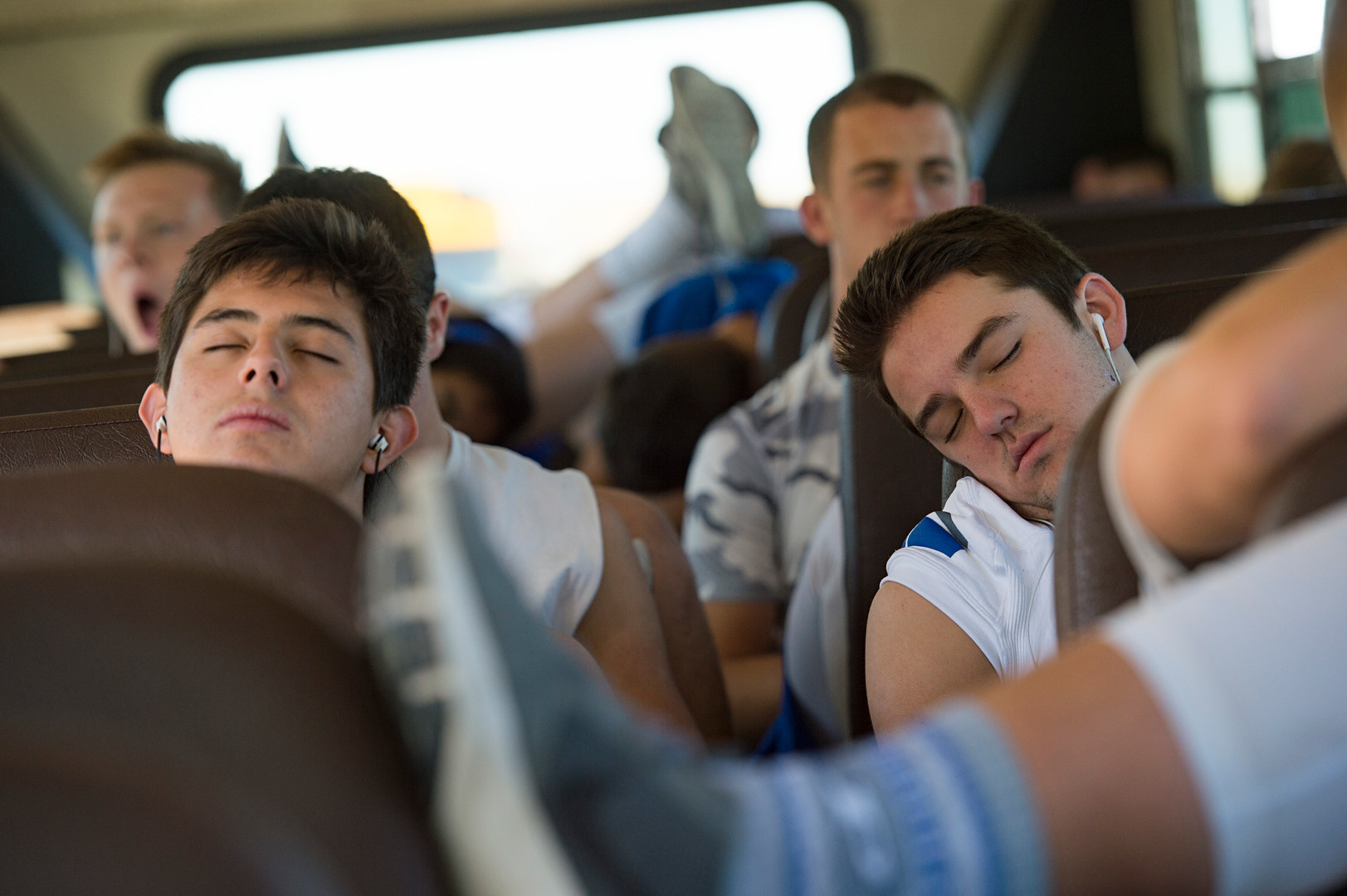 3:19 p.m. - Poudre High School football players Jordan Castenada and Carter Finch take a nap on the on the bus ride to a game against Legend High School in Parker Thursday, October 13, 2016.
