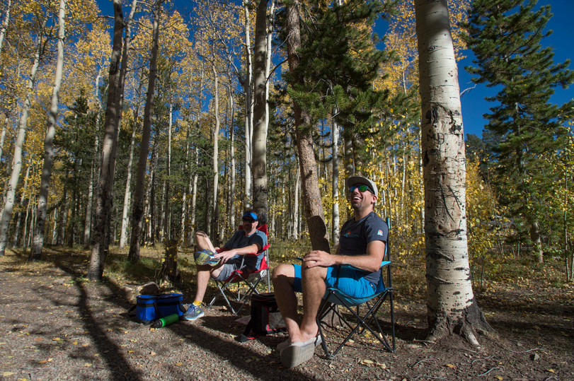 Bryce Cole and Tim Gormley of Denver relax with a beer under a canopy of fall colors near Kenosha Pass on Thursday, September 21, 2017.