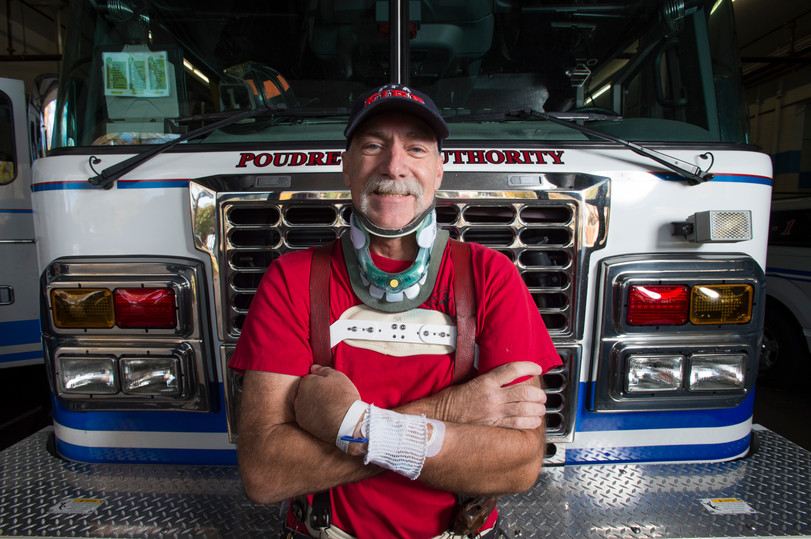 """Dean DeLaney shows off his mustache at Station 1 in Fort Collins. Delaney was involved in an ATV accident in late September, fracturing vertebrae and sustaining life-threatening injuries. Station 1 firefighters grew out their mustaches as a tribute to Dean, who has only shaved his a few times in the last 35 years, giving a new take to """"Movember."""" Delaney has regained about 50% of the movement in his left arm along with some dexterity in his back but hospital bills are piling up. To support Dean, t-shirts and coins with #DeLaneyStrong are available to assist with bills. AUSTIN HUMPHREYS/THE COLORADOAN"""