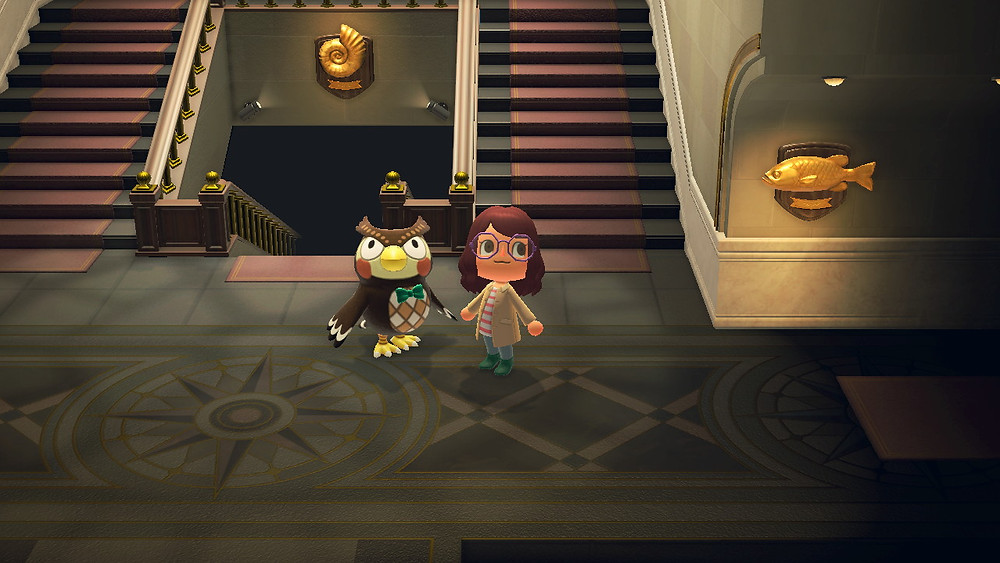 Blathers the owl curator in Animal Crossing stands in the lobby of his museum while a player character stands next to him