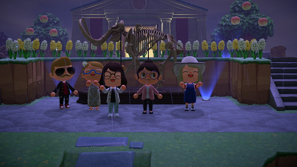 Animal Crossing players stand in front of a Mammoth skeleton that sits in front of the Museum