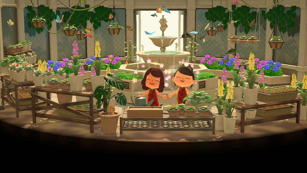 Two Animal Crossing players posing for a picture in a room filled with butterflies