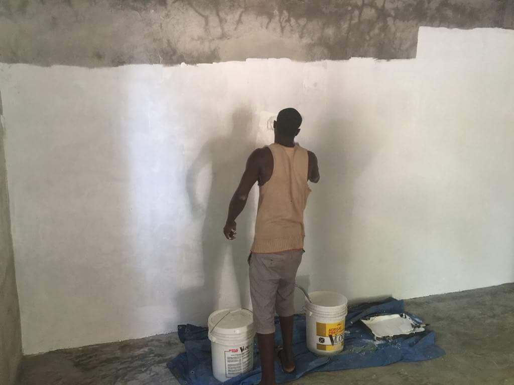 Watson painting the movie wall.