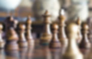 Chess pieces. Manufacturer operations will be impacted if the rebate rule is finalized.